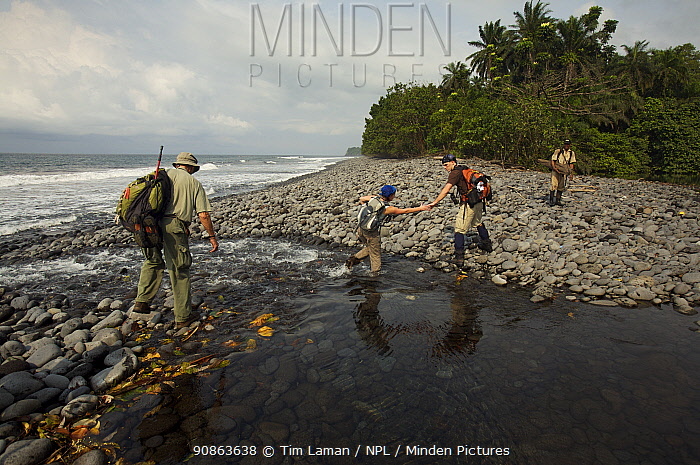 Expedition members trek along the South coast of Bioko, Equatorial Guinea, Rapid Assessment Visual Expedition, International League of Conservation Photographers, January 2008. Model released