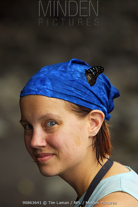 Butterfly on the head of a young woman, Barbara VanGilder, Bioko Island, Equatorial Guinea, Rapid Assessment Visual Expedition, International League of Conservation Photographers, January 2008. Model released