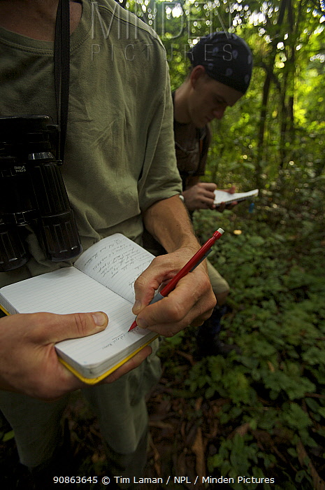 Primatologists, Tom Butynski and Jacob Owens, take notes on a monkey encounter during the trek into the caldera, Bioko Island, Equatorial Guinea, Rapid Assessment Visual Expedition, International League of Conservation Photographers, January 2008. Model released