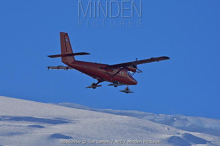 Airplane of the British Antarctic Survey flying past Hansen Island and the Arrowsmith Peninsula, Antarctica, February 2009