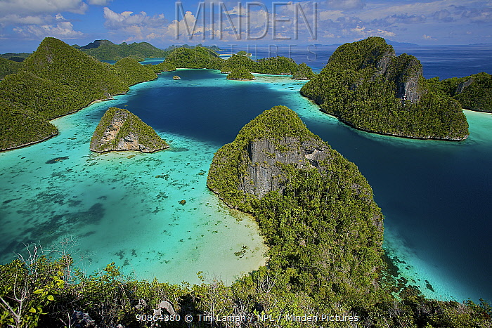 Aerial view of the Wayag Islands, an uninhabited group of uplifted limestone (karst) islands, NW of Waigeo Island. West Papua, Indonesia, April 2007
