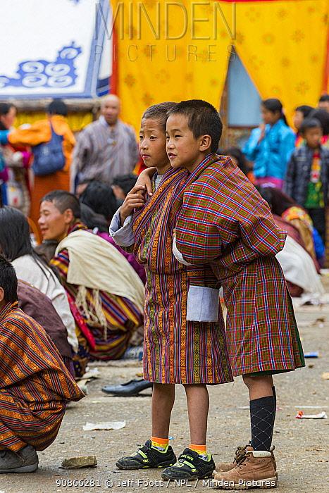 Children / boys , watching Haa Tsechu festival at the 'white chapel'. Bhutan. September 2013.