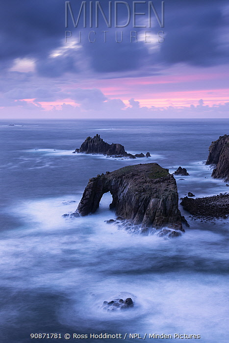 Enys Dodnan sea arch and the Armed Knight rock, Land's End, Cornwall, UK. October 2016.