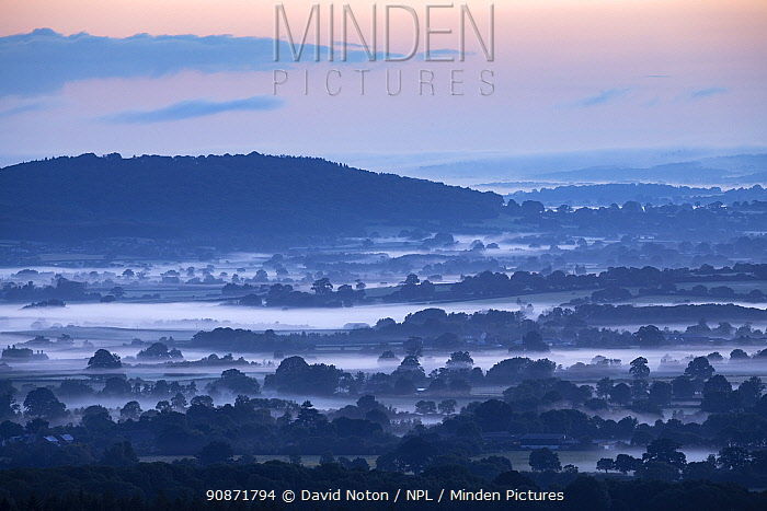 Dawn on the longest day in the Blackmore Vale, from Okeford Hill, Dorset, England, UK. June 2019.