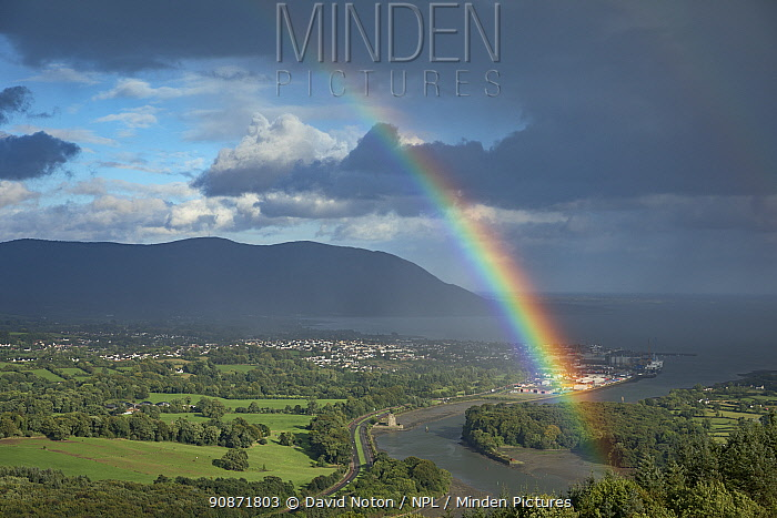 Rainbow over the Newry River (which marks the Eire/UK border) and Warrenpoint from Flagstaff, County Down, Northern Ireland, UK. August 2018.