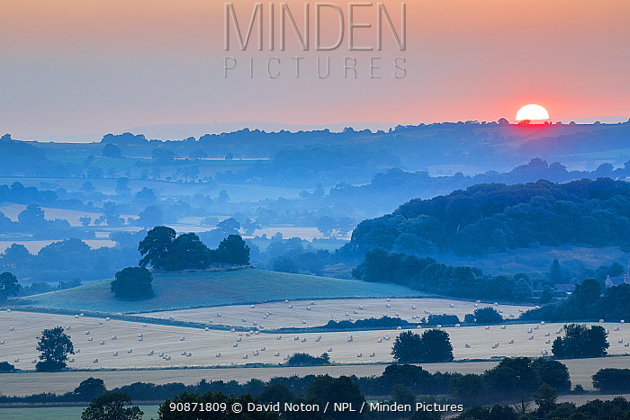 Sunrise on a summer's morning over the countryside near Compton Pauncefoot, Somerset, England, UK. July 2018.