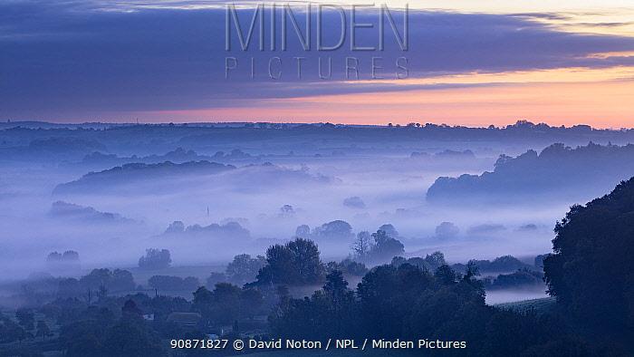 Misty autumnal dawn over Compton Pauncefoot from Cadbury Castle, South Somerset, England, UK.. October 2018.