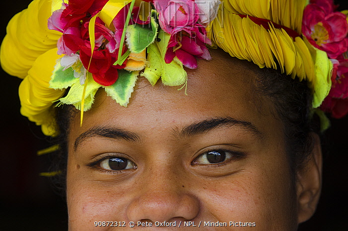 Woman wearing traditional floral headdress for ceremony, Kioa Island, Fiji, South Pacific, July 2014.