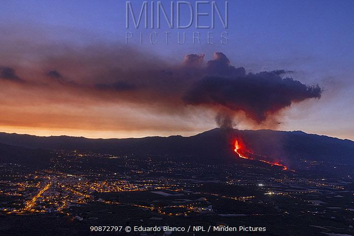 Volcanic eruption with lava flow moving toward area of human habitation, Cumbre Vieja Volcano. La Palma, Canary Islands. Spain. Europe. September 2021.