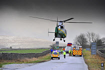 Air Ambulance attending road traffic accident in icy weather, Kirkby Stephen, Cumbria, England, December  -  Wayne Hutchinson/ FLPA