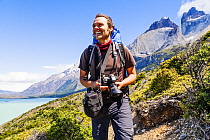 Photographer hiking W Trek, Torres del Paine National Park, Patagonia, Chile. January 2014. Model released.