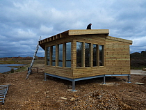 Construction of the new Tern Hide beside Ibsley Water, Blashford Lakes Nature Reserve. Hampshire and Isle of Wight Wildlife Trust Reserve, Ellingham, near Ringwood, Hampshire, England, UK, March 2019