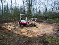 Digging for the new educational dipping pond, Blashford Lakes Nature Reserve. Hampshire and Isle of Wight Wildlife Trust Reserve, Ellingham, near Ringwood, Hampshire, England, UK, January 2019