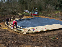 Preparatory work for construction of educational dipping pond with the liner in place, Blashford Lakes Nature Reserve. Hampshire and Isle of Wight Wildlife Trust Reserve, Ellingham near Ringwood, Hamp...